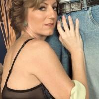 Leggy granny Avalynne O'Brien demonstrates upskirt panties while seducing a black guy