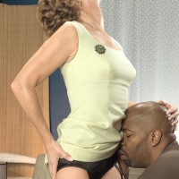 Gangly grandma Avalynne O'Brien seduces a ebony stud in stockings and garters