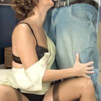 Gangly grandma Avalynne O'Brien seduces a ebony stud in stockings and garters