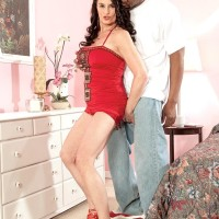 lean grandma Rita Daniels entices a younger ebony dude in a short crimson sundress and high-heels