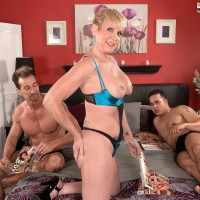 Gangly over 50 blond MILF Honey Ray screwing TWO men with monster-sized cocks in MMF Threeway
