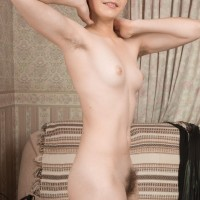 Gangly redhead amateur Aria wears her hair short while showing her all natural twat