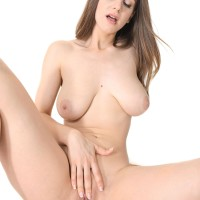 Leggy babe Stella Cox uncovers her hefty all natural funbags as she strips to masturbate