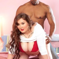 Lengthy haired BIG SEXY LADY Lilli Blue jerks on a BIG EBONY PENIS after having her huge ass and tits liberated