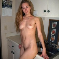 Long legged first timer shows off her furry armpits and all natural beaver on top a bed