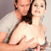 Tall cougar Lorenzia entices the handyman in a short sundress and nylons