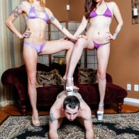 Long-legged swimsuit attired women Sophia and Lucille abase a submissive male