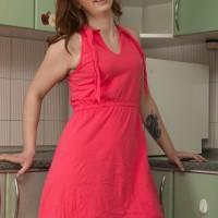 Long sock adorned amateur Kira Fox unsheathing petite fun bags and hairy muff in kitchen