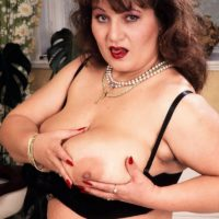 Aged BBW Ildiko plays with her immense melons in stunning tights during solo activity