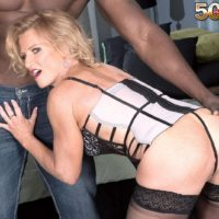 Mature golden-haired Amanda Verhooks welcomes her younger ebony paramour in spectacular lingerie