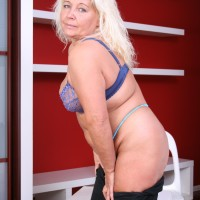 Mature fair-haired BIG HOT LADY disrobing out of micro-skirt and lingerie to pose plus-sized rump in the naked