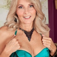 Accomplished ash-blonde Chery Leigh seduces her younger lover in hot lingerie and hose