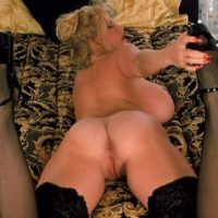 Mature golden-haired Kayla Kleevage takes self shots of her tan lined bum in black nylons