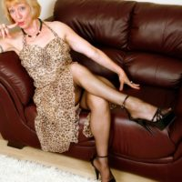Experienced light-haired broad hikes up her sundress in order to toy her snatch in black nylons