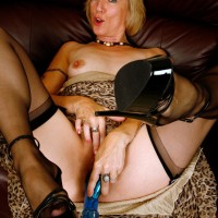 Older light-haired woman hikes up her sundress in order to toy her honeypot in ebony hosiery