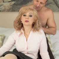 Older platinum-blonde doll Veronique giving oral jobs after receiving loosening massage