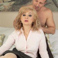 Older platinum-blonde doll Veronique giving oral jobs after receiving loosening massage