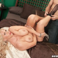 Mature blond MILF Karen Fisher is disrobed of her lingerie and stockings by her lover