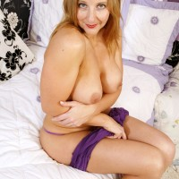 Aged yellow-haired model baring immense all natural titties from bra before vaunting super-cute bum