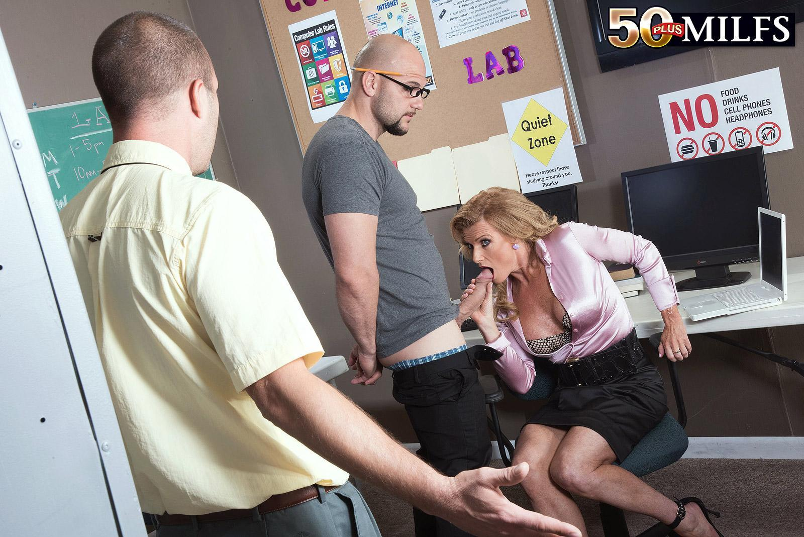 Aged platinum-blonde tutor Amanda Verhooks caught providing oral sex in microskirt