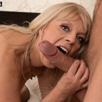 Mature blonde lady slurps and bj's on a massive penis in her ebony stockings