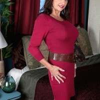 Senior woman Ciara is disrobed to her boulder-holder and panties in a bedroom by her paramour