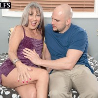 Older doll Leilani Lei and junior man undressing each other on her bed