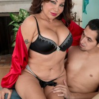 Older woman Sandra Martines entices a younger stud in boulder-holder and panties concoction