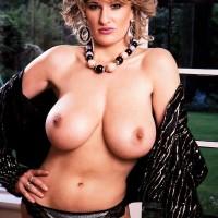 Older MILF Debbie Q proudly demonstrates her fine titties in ebony panties