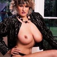 Older MILF Debbie Q proudly demonstrates her fine titties in ebony panties