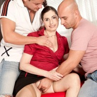 Mature MILF Lorenzia has her honeypot and arse caressed by her younger lovers on a couch