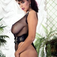 Experienced MILF porno starlet Jeannine Oldfield tongues the nips of her big funbags in see thru lingerie