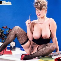 Experienced MILF Tracy West sets her gigantic boobies loose in fishnet hose and high heeled shoes