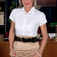 Older office worker Cheyanne seduces the janitor in a miniskirt and glasses