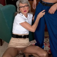 Mature office place worker Cheyanne seduces the janitor in a mini-skirt and glasses