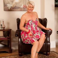 Mature platinum platinum-blonde looses her tiny titties as she strips to high-heeled shoes on a leather tabouret