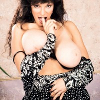 Older porno starlet Huge-chested BriAnna sets her enormous fun bags free and her trimmed cunny too