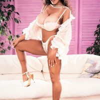 Older X-rated star Huge-titted BriAnna sets her humungous boobs loose in a thong and high-heeled shoes