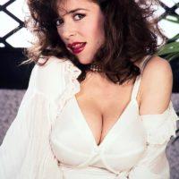 Elder XXX pornstar Diana Wynn frees her giant tits from her retro styled boulder-holder