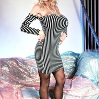 Aged pornstar Pandora Peaks extracts her massive boobies from her taut dress