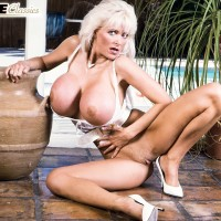 Experienced porno starlet Platinum Peaks frees massive hooters from melon-holder in lace underwear and high heeled shoes