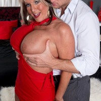 Experienced XXX starlet Sally D'Angelo showcasing amazing gams and uncovering hefty titties