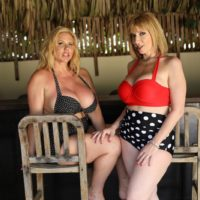 Senior porn industry stars Karen Fisher and Sara Jay have lezzie sex while on a covered patio