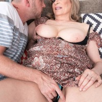 Aged dame Crystal King has her immense tits toyed with by a younger stud
