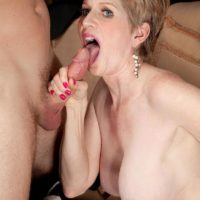 Mature broad Sindee Dix is unclothed naked before fellating her younger lover