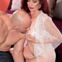 Aged woman with crimson hair Dana Devereaux face sits her toy stud after delivering a blowjob