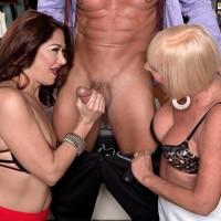 Mature gals Renee Black and Scarlet Andrews take turns slurping a hard cock