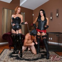 Michelle Lacy and a cool girlfriend dominate a hooded masculine in spandex and long boots