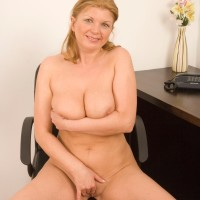 Middle senior gal doing away with microskirt and lingerie to model naked at work place desk