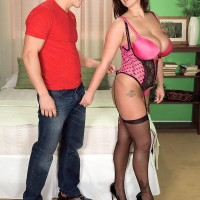 MILF XXX pornstar Eva Notty lets fun bags free to titty smother her lover